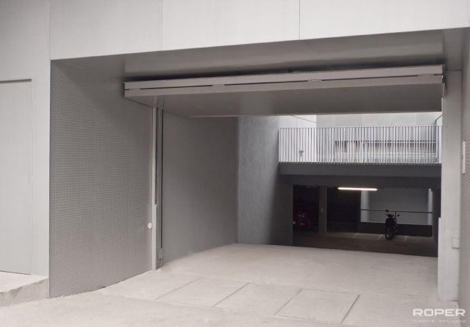puerta de garaje basculante hojas comunitaria