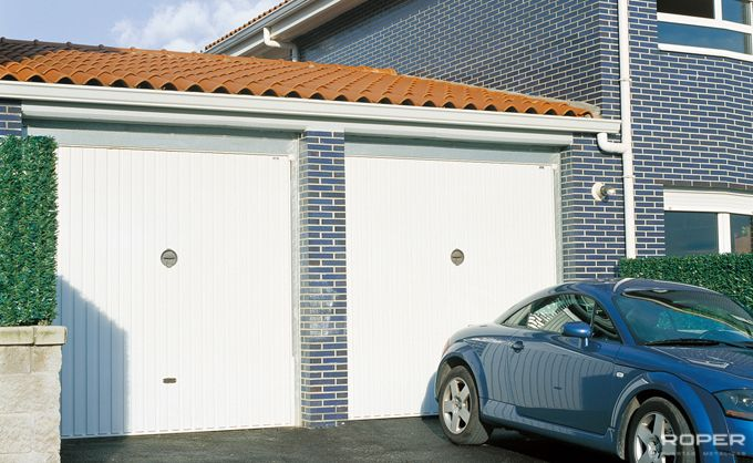 Puertas de garaje roper materiales de construcci n para for Puerta garaje basculante precio